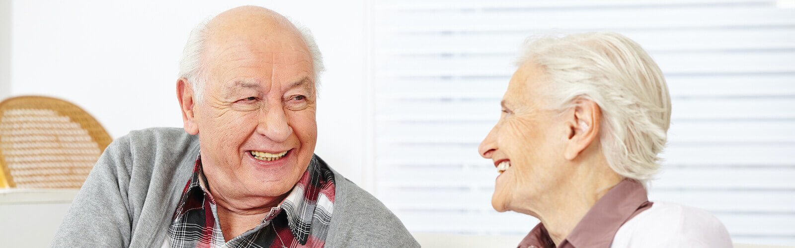 Elderly couple embracing each other.