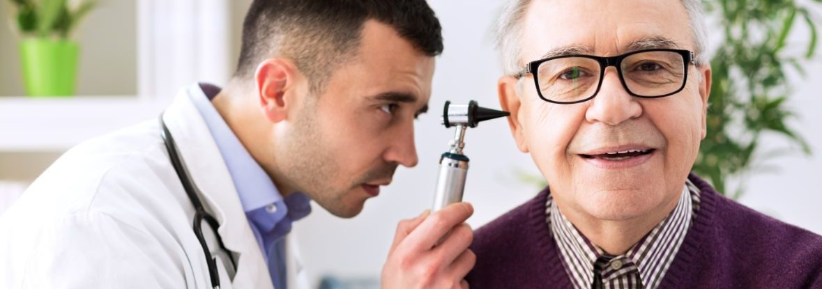 A senior man is examined during a doctor's visit.